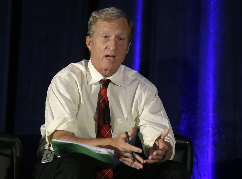 In this Oct. 7, 2015, file photo, billionaire environmentalist Tom Steyer discusses climate change at a symposium in Sacramento, Calif.