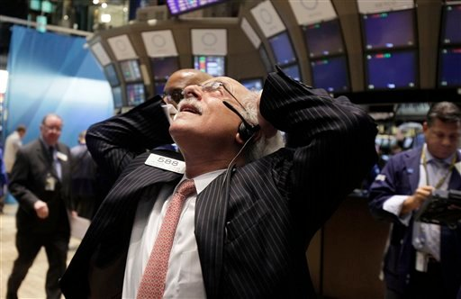 Trader Peter Tuchman works on the floor of the New York Stock Exchange Wednesday, Aug. 10, 2011. (AP Photo/Richard Drew)