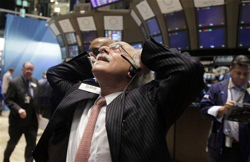 Trader Peter Tuchman works on the floor of the New York Stock Exchange Wednesday, Aug. 10, 2011. (AP Photo/Richard Drew)