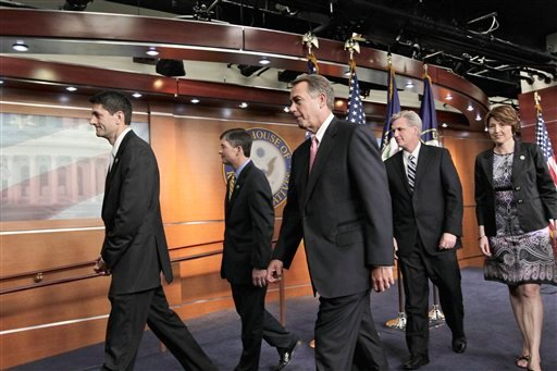 House Speaker John Boehner of Ohio, center, and fellow House Republican leaders, leave a news conference on Capitol Hill in Washington Aug. 1, 2011. (AP Photo/J. Scott Applewhite)