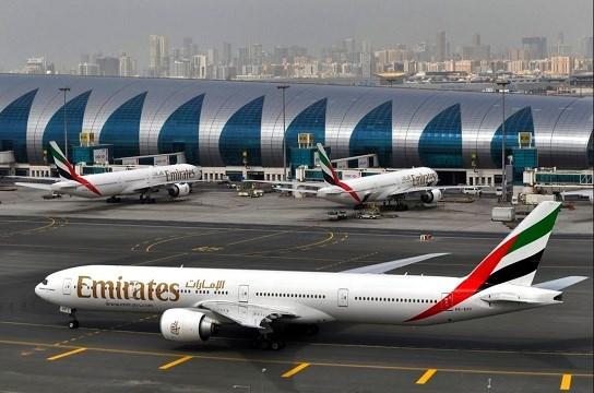 Emirates plane taxis to a gate at Dubai International Airport at Dubai International Airport in Dubai.