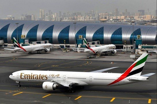Emirates plane taxis to a gate at Dubai International Airport at Dubai International Airport in Dubai.