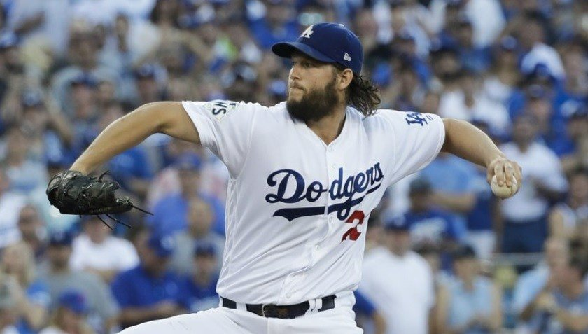 LA Dodgers starting pitcher Clayton Kershaw throws during first inning of Game 1.