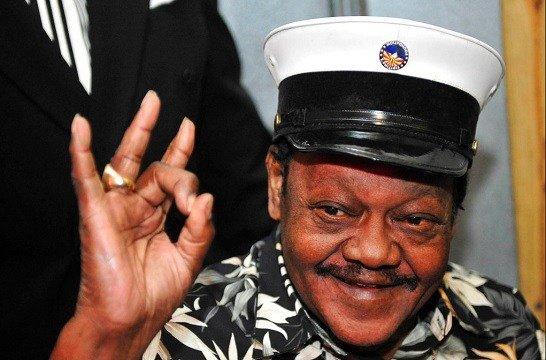 Fats Domino waves to fans before a ceremony re-presenting two Grammy awards to replace the ones that he lost from Hurricane Katrina.