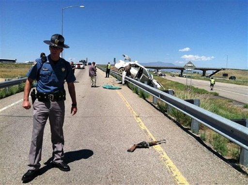 Photo provided by the Colorado State Patrol: Authorities investigate scene where three fugitive siblings wanted in a crime spree in Florida and Georgia were captured Aug. 10, 2011, along Interstate 25 in Walsenburg, Colo. (AP Photo/Colorado State Patrol)