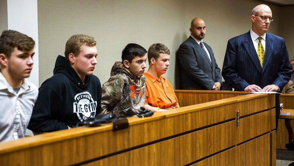 Trevor Gray, Alexzander Miller, Mikadyn Payne, and Kyle Anger appear for their arraignment in front of Judge William Crawford (Terray Sylvester /The Flint Journal-MLive.com via AP)