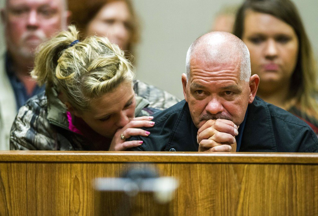 Family of Ken White, who was killed when a rock was thrown from an overpass on Interstate 75, listen as the alleged perpetrators are arraigned on Tuesday, Oct. 24, 2017 (Terray Sylvester /The Flint Journal-MLive.com via AP)