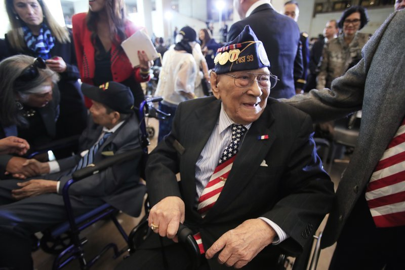 Celestino Almeda, a Filipino World War II veteran, smiles during a ceremony at the Emancipation Hall on Capitol Hill in Washington, Wednesday, Oct. 25, 2017.
