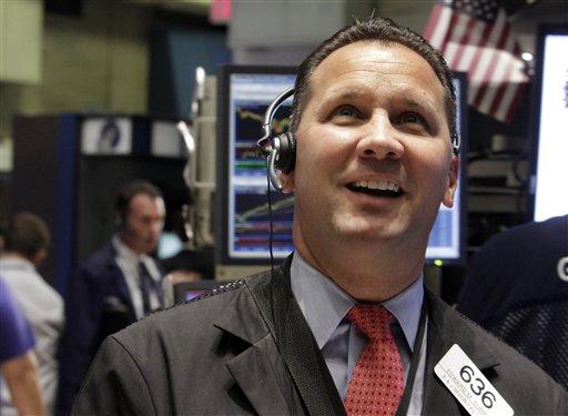 Trader Edward Curran smiles as he works on the floor of the New York Stock Exchange Thursday, Aug. 11, 2011. (AP Photo/Richard Drew)
