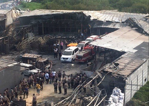 Police officers and rescuers inspect the site of an explosion at a firecracker factory in Tangerang, on the outskirts of Jakarta, Indonesia.