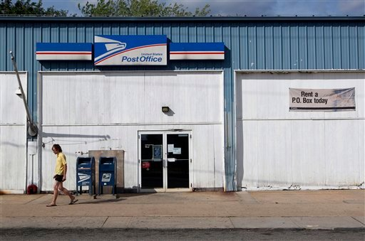 A man walk away from the Handy Street Post Office after hours Wednesday, July 27, 2011, in New Brunswick, N.J.