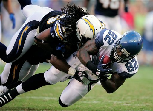 Seattle Seahawks tight end Dominique Byrd (82) is brought down by San Diego Chargers safety C.J. Wallace during the second half of their preseason NFL football game at Qualcomm Stadium, Thursday, Aug. 11, 2011, in San Diego. (AP Photo/Mark J. Terrill)