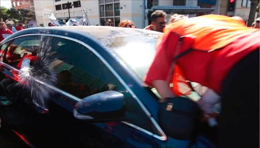 In this still image taken from video and released by Unite Here Local 11, a motorist drives his car into marchers at an immigrant rights rally in Brea, Calif., Thursday, Oct. 26, 2017. (Antonio Mendoza/Unite Here Local 11 via AP)