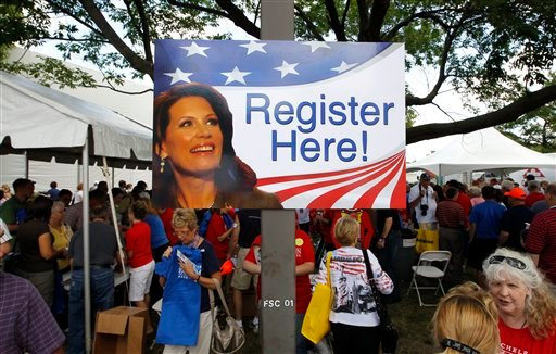 Iowa residents register to vote for Republican presidential candidate Rep. Michele Bachmann, R-Minn. at the GOP Straw Poll in Ames, Iowa, Saturday, Aug. 13, 2011. (AP Photo/Charles Dharapak)