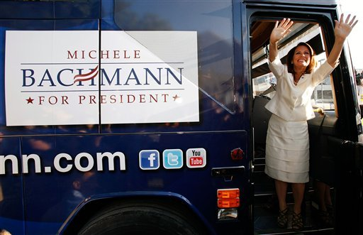 Republican presidential candidate Rep. Michele Bachmann, R-Minn., waves from the steps of her campaign bus after being named the winner of the Iowa Republican Party's Straw Poll, Saturday, Aug. 13, 2011, in Ames, Iowa. (AP Photo/Charlie Neibergall)
