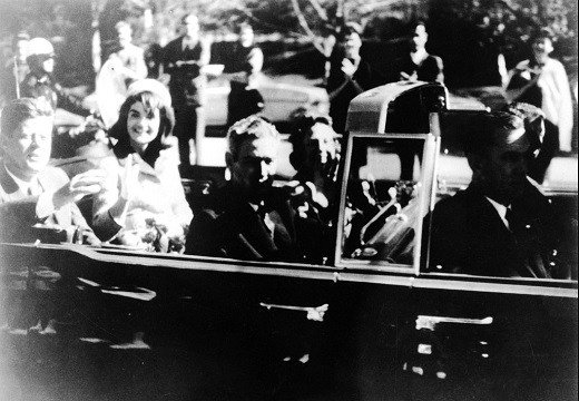 President John F. Kennedy at the extreme right on rear seat of his limousine during Dallas, motorcade on Nov. 22, 1963.