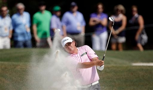 Jason Dufner hits out of a bunker on the fifth hole during the final round of the PGA Championship golf tournament Sunday, Aug. 14, 2011, at the Atlanta Athletic Club in Johns Creek, Ga. (AP Photo/David J. Phillip)