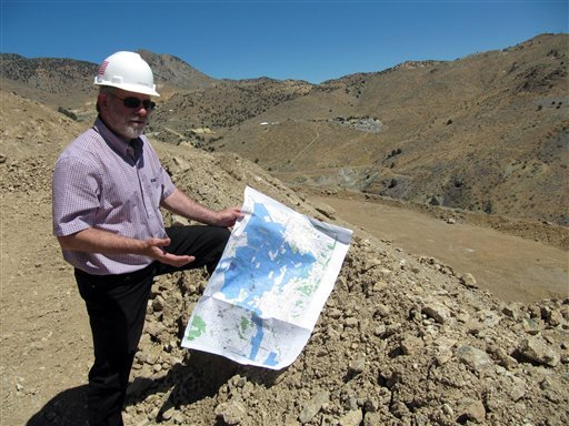 July 25, 2011 photo: Doug McQuide, of Comstock Mining Inc., explains the company's plans for open pit mining near Gold Hill, Nev. (AP Photo/Sandra Chereb)