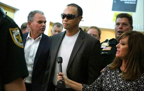 Golfer Tiger Woods, center, leaves the North County Courthouse in Palm Beach Gardens, Fla.