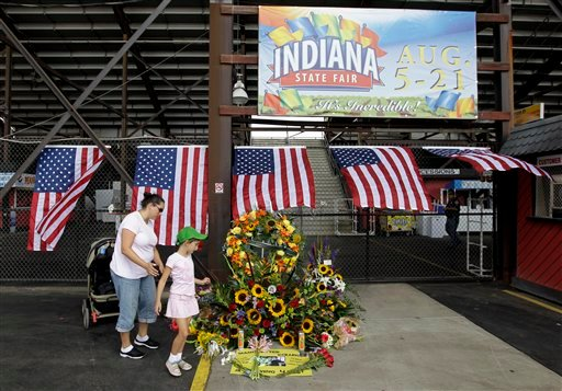 Jennifer Dominianni along with her daughter, Natania, look at a memorial in front of the Grandstand at the Indiana State Fair in Indianapolis, Monday, Aug. 15, 2011.