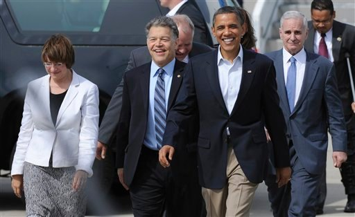 President Barack Obama walks with, from left, Sen. Amy Klobuchar, D-Minn., Sen. Al Franken, D-Minn., and Minn., Gov. Mark Dayton, upon his arrival at the Minneapolis St. Paul Airport Aug. 15, 2011. (AP Photo/Hannah Foslien)