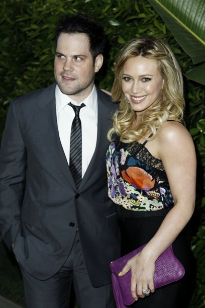"FILE - In this May 11, 2011 file photo, actress Hilary Duff, right, and her husband Mike Comrie arrive at an Evening of ""Southern Style"" presented by The St. Bernard Project and the Spears Family in Beverly Hills, Calif. Duff announced in an Aug. 14, 2011"