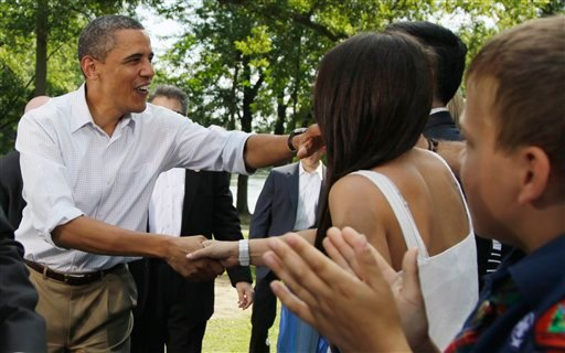President Barack Obama shakes hands as he arrives to speak at a town hall meeting, Monday, Aug. 15, 2011, at Lower Hannah's Bend Park in Cannon Falls, Minn.