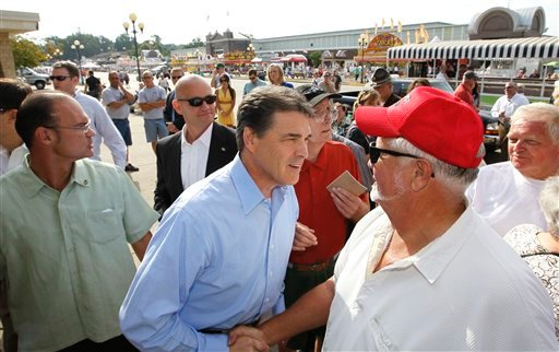 Republican presidential candidate, Texas Gov. Rick Perry, visits the Iowa State Fair in Des Moines, Iowa, Monday, Aug. 15, 2011.