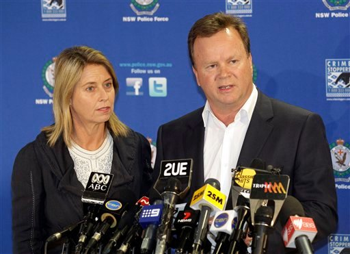 William Pulver makes a statement with his wife Belinda at his side, regarding the arrest of a 50-year-old man, in Sydney, Australia Tuesday, Aug. 16, 2011. (AP)