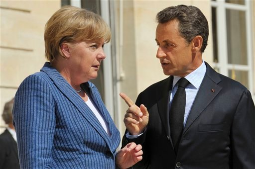 France's President Nicolas Sarkozy, right, speaks to German Chancellor Angela Merkel as he welcomes the German leader at the Elysee Palace, in Paris Tuesday Aug. 16, 2011. (AP Photo/Philippe Wojazer, Pool)