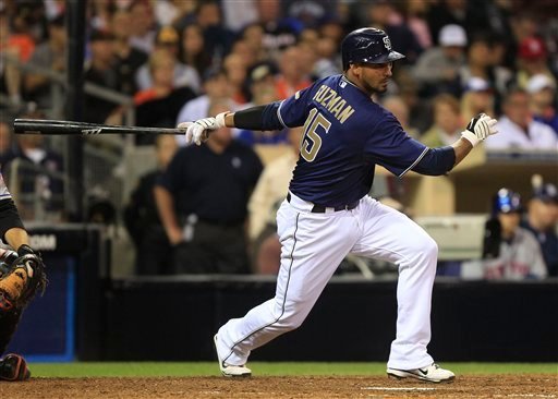 San Diego Padres' pinch hitter Jesus Guzman drives a single to right that brings in the tie run against the New York Mets in the eighth inning of a baseball game Monday, Aug. 15, 2011 in San Diego. (AP Photo/Lenny Ignelzi)