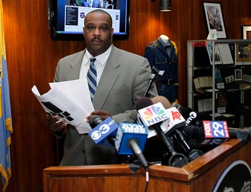 Philadelphia police homicide commander Capt. James Clark arrives to speak at a media availability Tuesday, Aug. 16, 2011, in Philadelphia.