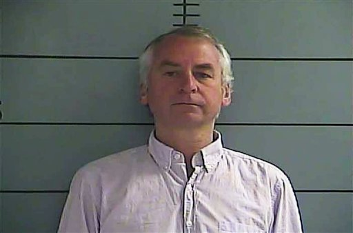 """Paul """"Doug"""" Peters, 50, is seen in a booking photo taken by authorities at the Oldham County Jail in LaGrange, Ky. and made available by WLKY-TV in Louisville, Ky, Tuesday Aug. 16, 2011."""