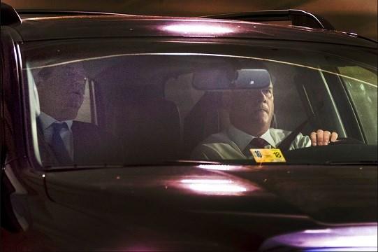 Former Trump Campaign Chairman Paul Manafort, left, leaves his home in Alexandria, Va.