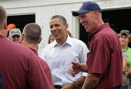 President Barack Obama greets people as he visits the Whiteside County Fair, Wednesday, Aug. 17, 2011, in Morrison, Ill., during his three-day economic bus tour. (AP Photo/Carolyn Kaster)