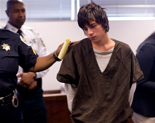 Jared Cano center, is led out of the courtroom in Tampa, Fla. Aug. 17, 2011 after being charged with possession of bomb-making materials in connection with a plot for an attack at Freedom High School. (AP Photo/St. Petersburg Times, Cherie Diez)
