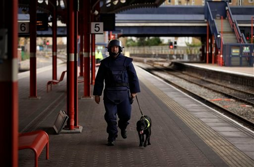 A police sniffer dog team take part in a police training exercise at Marylebone train station in London, Wednesday, Aug. 17, 2011. (AP Photo/Matt Dunham)