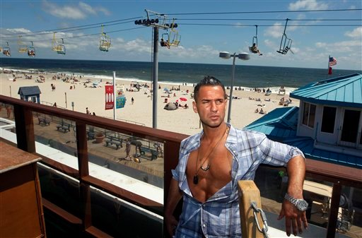 """Mike """"The Situation"""" Sorrentino, cast member of MTV's """"Jersey Shore"""" stands on a deck overlooking the boardwalk and beach at the home for the show Thursday, Aug. 4, 2011, in Seaside Heights, N.J."""