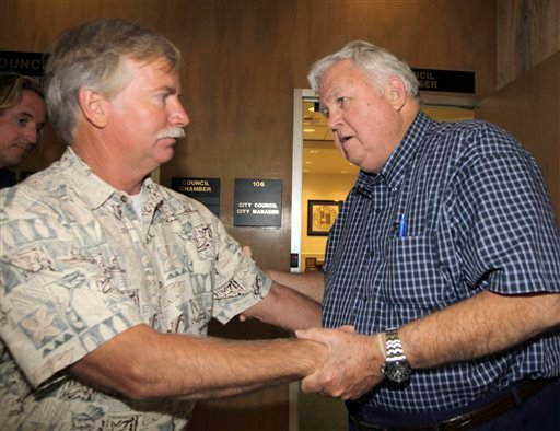 Ron Thomas father of Kelly Thomas, left, says goodbye to City of Fullerton Mayor Richard Jones after a meeting Wednesday Aug. 17, 2011 in Fullerton, Calif.