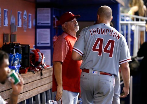 Philadelphia Phillies hitting coach Matt Stairs, left, talks with starting pitcher Jake Thompson (44) during a baseball game against the Miami Marlins, Sunday, Sept. 3, 2017, in Miami. The Phillies won 3-1. (AP Photo/Lynne Sladky)