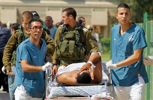 Israeli medics evacuate a person wounded in one of several attacks in the Arava desert, to the Soroka hospitan in Beersheba, southern Israel, Thursday, Aug. 18, 2011. (AP Photo/Ilan Assayag)