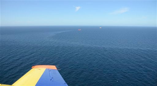 In this image released by Scotland's government marine surveillance agency on Tuesday Aug 17 2011, a sheen of leaked oil can be seen off the east coast of the country.