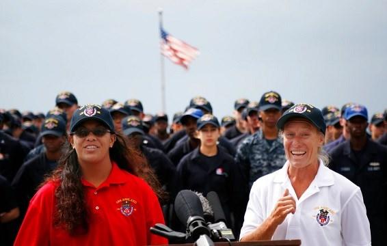 Jennifer Appel, right, and Tasha Fuiava speak on the deck of the USS Ashland at White Beach Naval Facility in Okinawa, Japan.