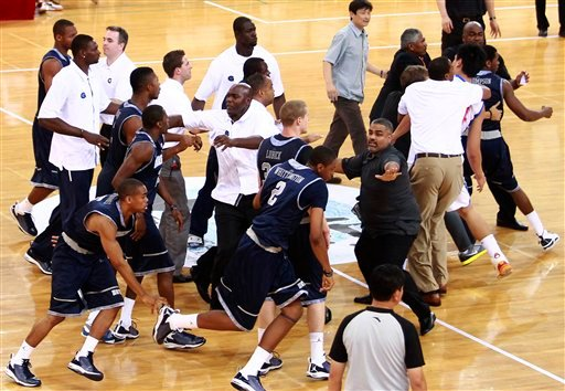 Team officials try to calm down Georgetown University basketball players during their exhibition game against China's Bayi Rockets in Beijing, China, Thursday, Aug. 18, 2011.