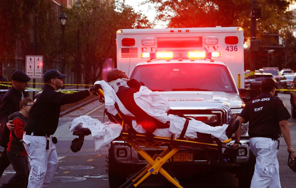 Emergency personnel transport a man on a stretcher after a motorist drove onto a busy bicycle path near the World Trade Center memorial and struck several people Tuesday, Oct. 31, 2017, in New York. (AP Photo/Mark Lennihan)