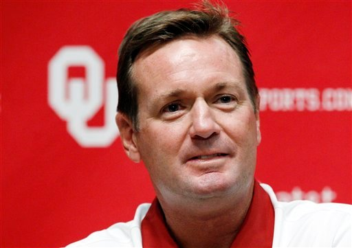 Oklahoma head coach Bob Stoops looks on during Oklahoma football media day in Norman, Okla. The Sooners will start out top-ranked in The Associated Press college football poll for the 10th time, more than any program in the country. (AP Photo/Sue Ogrocki)