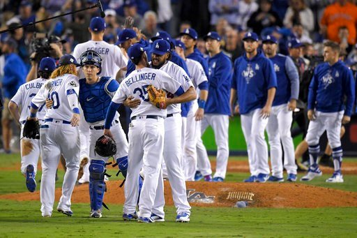 The Los Angeles Dodgers celebrate after their win against the Houston Astros in Game 6 of baseball's World Series Tuesday, Oct. 31, 2017, in Los Angeles. The Dodgers won 3-1 to tie the series at 3-3.(AP Photo/Mark J. Terrill)