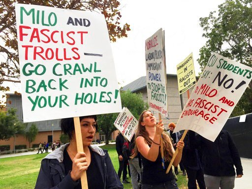 Demonstrators protest outside a speech by conservative provocateur Milo Yiannopoulos, sponsored by a Republican student group at California State University, Fullerton, Tuesday, Oct. 31, 2017. (AP Photo/Amanda Lee Myers)