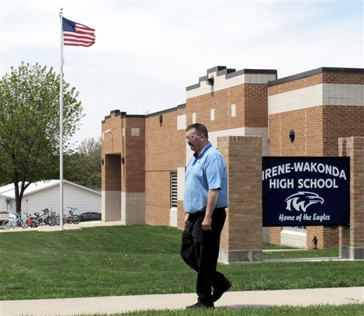 Brian Hansen, a parent from Irene, walks past lrene-Wakonda High School in Irene, S.D. This district, in the rolling farmland of southeastern South Dakota, is among a growing number that have adopted a four-day school week. (AP)