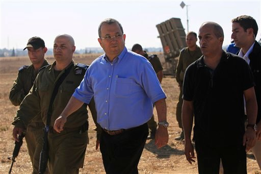 Israeli Defense Minister Ehud Barak, center, visits the Iron Dome missile defense system deployed in the city of Ashkelon in southern Israel, Sunday, Aug. 21, 2011. (AP)